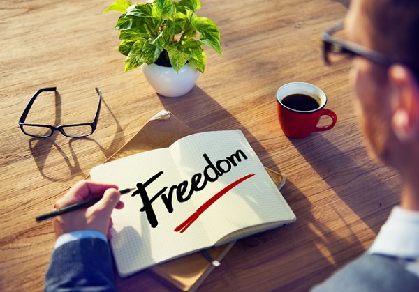 Man with Note Pad and Freedom Concept